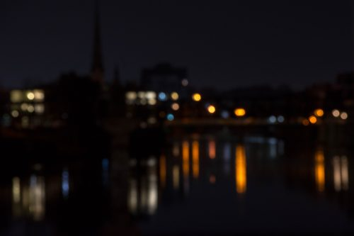 Bokeh photograph of reflections in the river at night